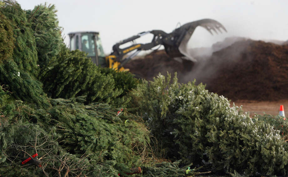 Heavy equipment moves mulch on Monday, January 4, 2010 at the City of San Antonio's Bitters Brush Recycling Center. The City of San Antonio has a Christmas tree recycling program taking place at the Bitters Brush Recycling Center, as well as eight other tree recycling locations around San Antonio.The city will accept the trees between 8 a.m. and 1 p.m. on Jan. 7-8 and Jan. 14-15. Photo: JOHN DAVENPORT, SAN ANTONIO EXPRESS-NEWS / jdavenport@express-news.net