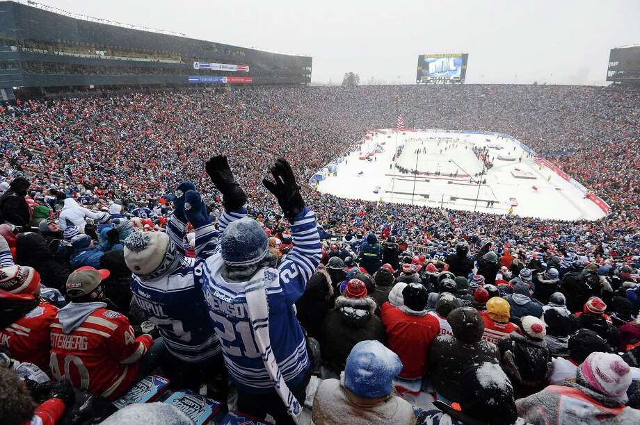 Maple Leafs fans, apparently with good eyesight, cheer a third-period goal. Photo: Jamie Sabau, Stringer / 2014 Getty Images