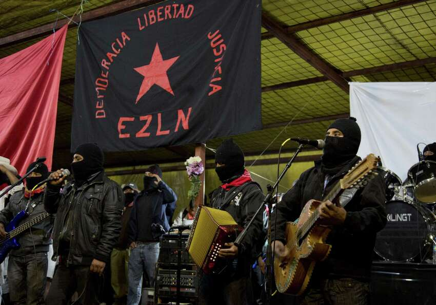 Masked members of the Zapatista Army of National Liberation celebrate the 20th anniversary of the group's uprising in Mexico's Chiapas state.