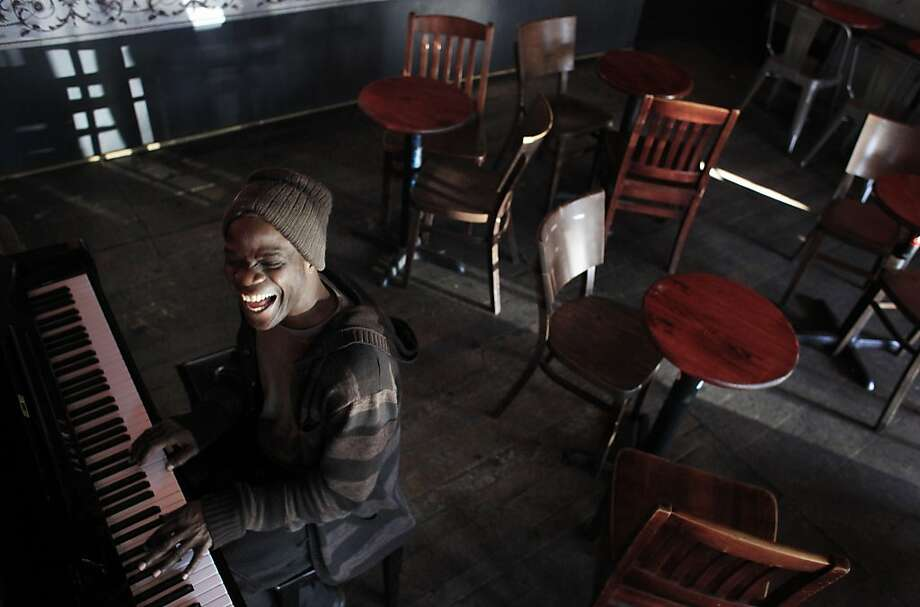 On the first morning of the new year, Walter Earl plays piano at the Revolution Cafe in San Francisco. Photo: Mike Kepka, The Chronicle
