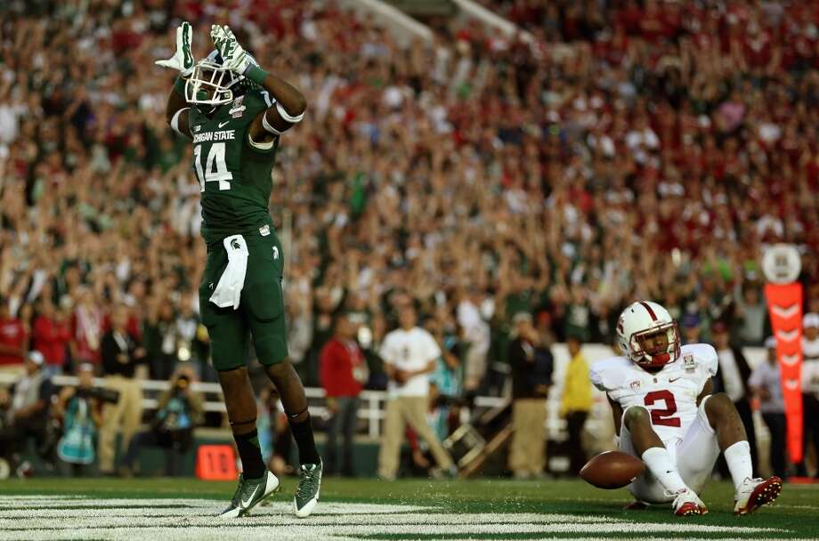 Wide receiver Tony Lippett #14 of the Michigan State Spartans celebrates a touchdown in the fourth quarter of the 100th Rose Bowl Game. Photo: Jeff Gross, Getty Images