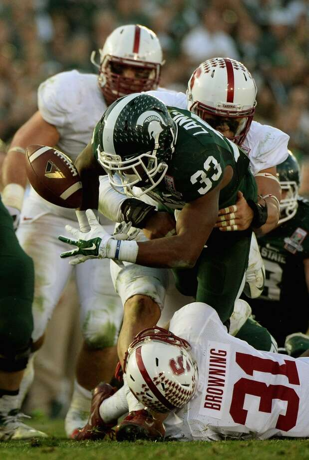 Running back Jeremy Langford #33 of the Michigan State Spartans fumbles the ball in the third quarter. Photo: Harry How, Getty Images