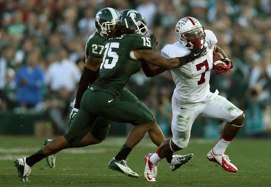 Wide receiver Ty Montgomery #7 of the Stanford Cardinal runs with the ball against the Michigan State Spartans during the 100th Rose Bowl Game. Photo: Jeff Gross, Getty Images