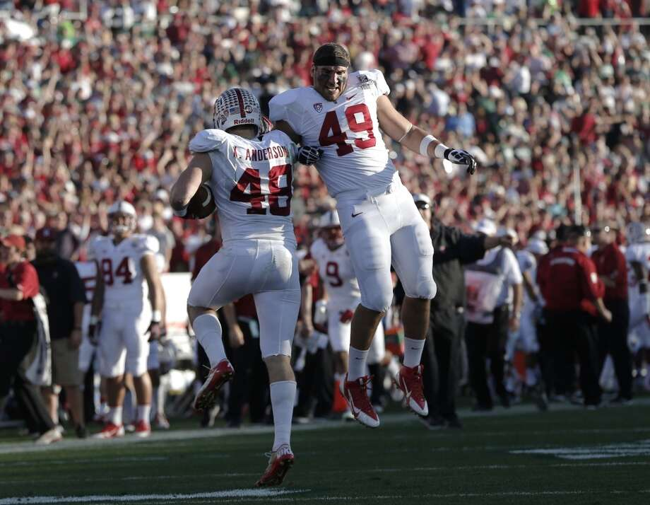 Stanford's Kevin anderson, (48) celebrates with teammate Ben Gardner, (46) after his second quarter pick six interception as the Stanford Cardinal and the Michigan State Spartans prepare to face off at the 100th Rose Bowl game in Pasadena, Ca. on Wednesday Jan. 1, 2014. Photo: Michael Macor, The Chronicle