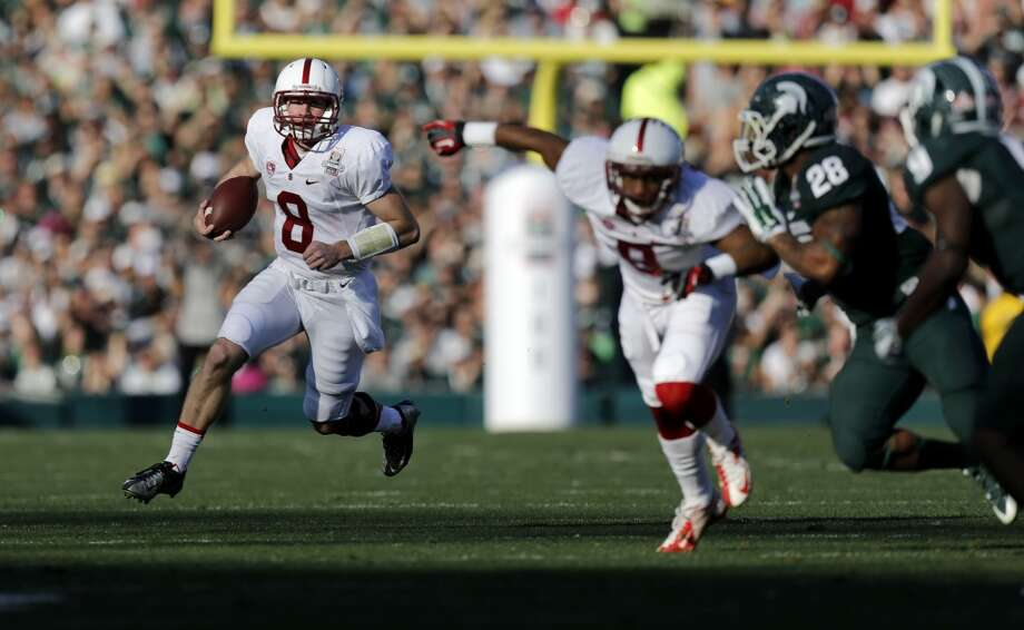 Stanford quarterback Kevin Hogan, (8) on a first quarter run for a first in the during the first second quarter, as the Stanford Cardinal and the Michigan State Spartans prepare to face off at the 100th Rose Bowl game in Pasadena, Ca. on Wednesday Jan. 1, 2014. Photo: Michael Macor, The Chronicle