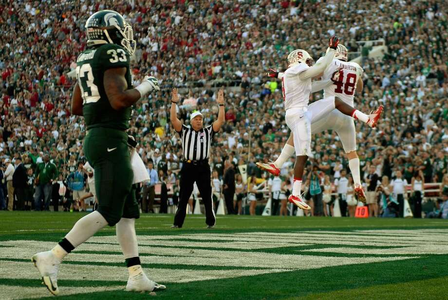 Linebacker Kevin Anderson of the Stanford Cardinal celebrates a interception returned for a touchdown against the Michigan State Spartans in the second quarter of the 100th Rose Bowl. Photo: Kevork Djansezian, Getty Images