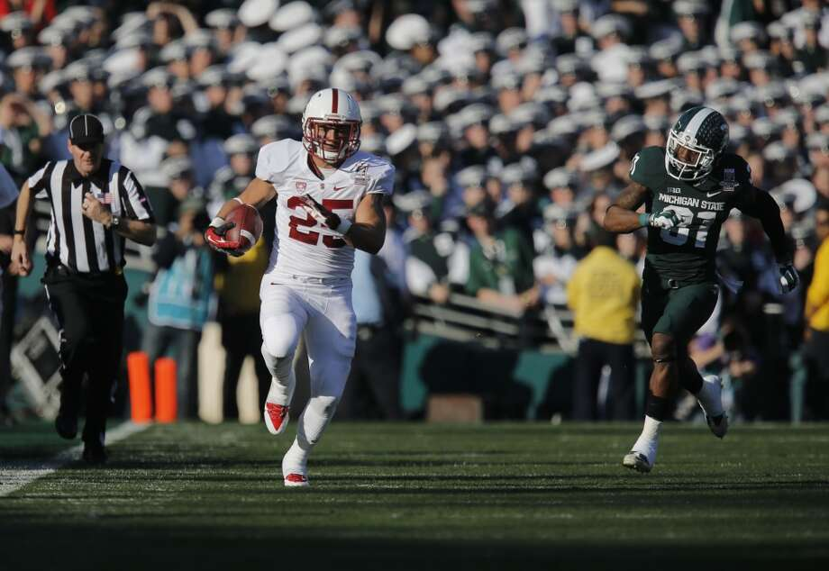Stanford's Tyler Gaffney, (25) on a 47 yard run during the first quarter, as the Stanford Cardinal and the Michigan State Spartans prepare to face off at the 100th Rose Bowl game in Pasadena, Ca. on Wednesday Jan. 1, 2014. Photo: Michael Macor, The Chronicle
