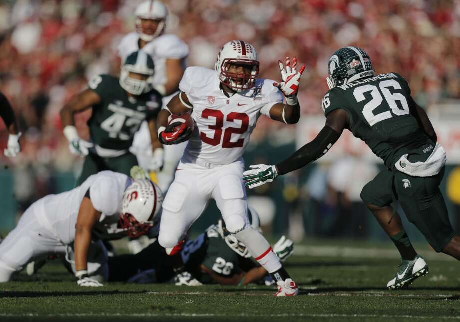 Stanford's Anthony Wilkerson, (32) on a first quarter 7 yard run, as the Stanford Cardinal and the Michigan State Spartans prepare to face off at the 100th Rose Bowl game in Pasadena, Ca. on Wednesday Jan. 1, 2014. Photo: Michael Macor, The Chronicle