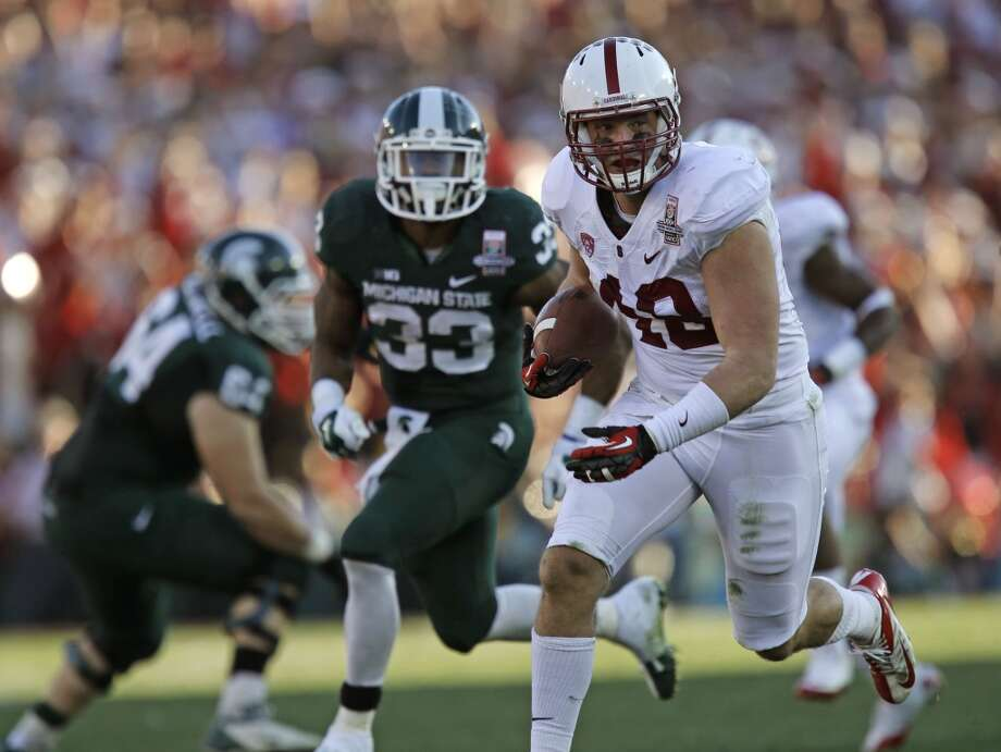 Stanford's Kevin Anderson, (48) heads for the end zone with his second quarter pick six interception as the Stanford Cardinal and the Michigan State Spartans prepare to face off at the 100th Rose Bowl game in Pasadena, Ca. on Wednesday Jan. 1, 2014. Photo: Michael Macor, The Chronicle