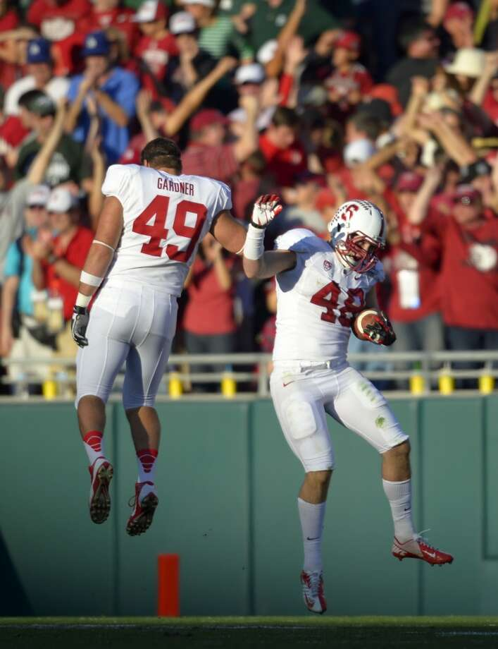 Stanford linebacker Kevin Anderson, right, celebrates a touchdown with defensive end Ben Gardner, during the first half of the Rose Bowl NCAA college football game against Michigan State on Wednesday, Jan. 1, 2014, in Pasadena, Calif. Photo: Mark J. Terrill, Associated Press
