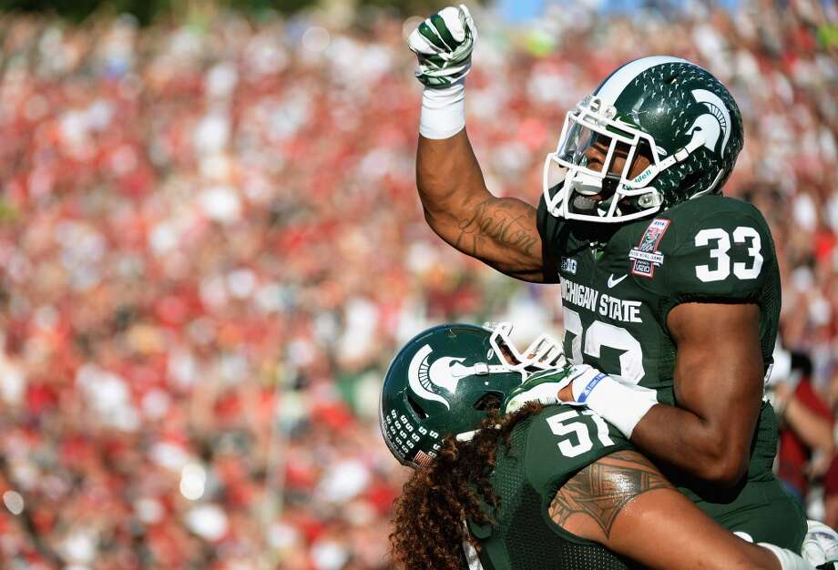 Running back Jeremy Langford #33 of the Michigan State Spartans celebrates a two yard touchdown run against the Stanford Cardinal in the second quarter of the 100th Rose Bowl Game presented by Vizio at the Rose Bowl on January 1, 2014 in Pasadena, California. Photo: Harry How, Getty Images