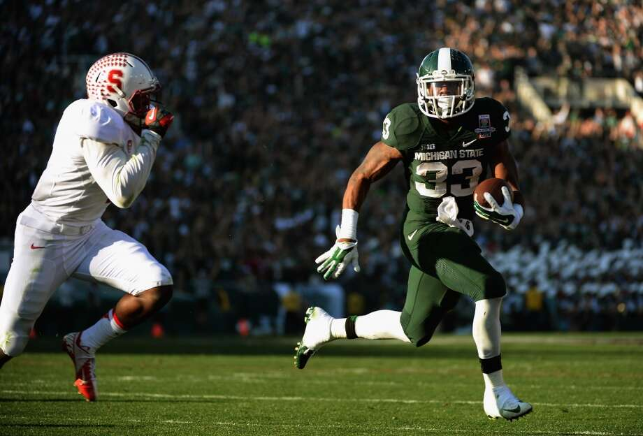 Running back Jeremy Langford #33 of the Michigan State Spartans runs for a two yard touchdown against the Stanford Cardinal in the second quarter. Photo: Harry How, Getty Images