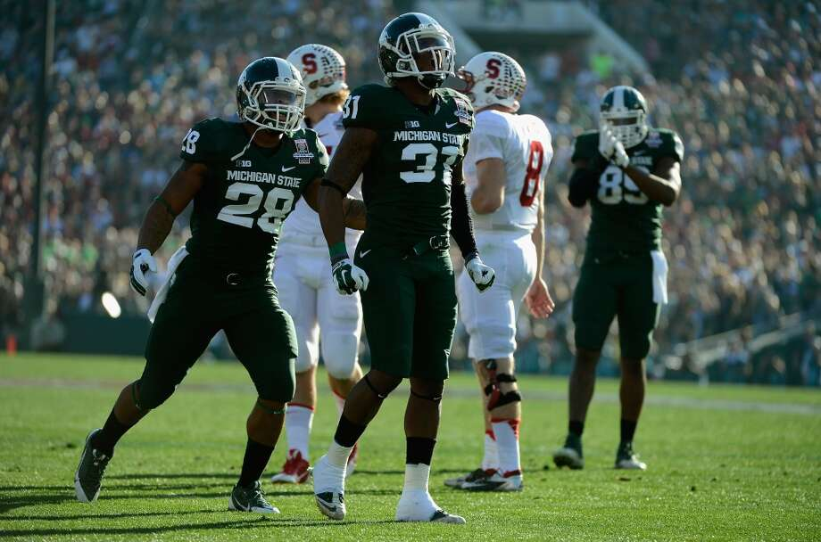 Cornerback Darqueze Dennard #31 of the Michigan State Spartans celebrates after a play against the Stanford Cardinal during the 100th Rose Bowl Game presented by Vizio at the Rose Bowl on January 1, 2014 in Pasadena, California. Photo: Kevork Djansezian, Getty Images