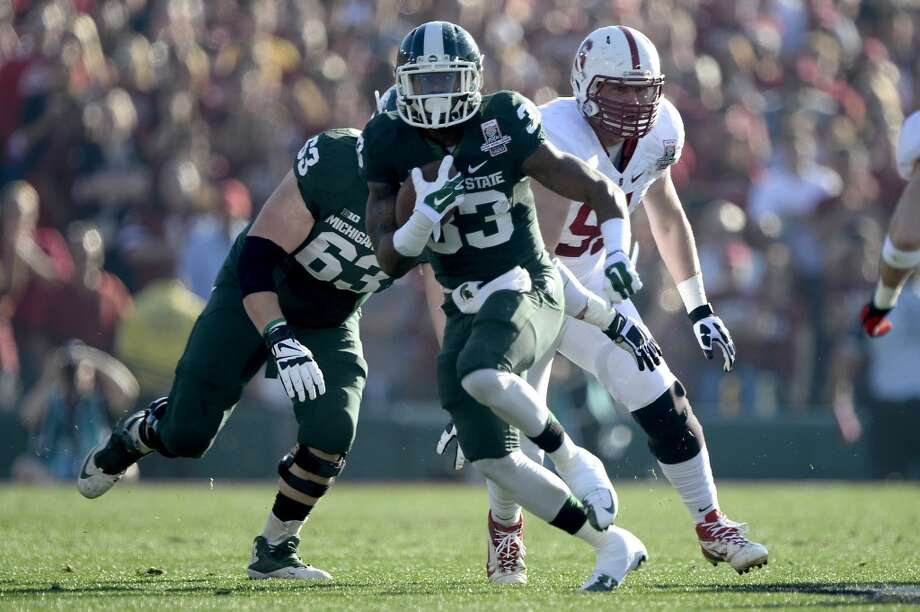 Running back Jeremy Langford #33 of the Michigan State Spartans runs with the ball against the Stanford Cardinal in the first quarter. Photo: Kevork Djansezian, Getty Images