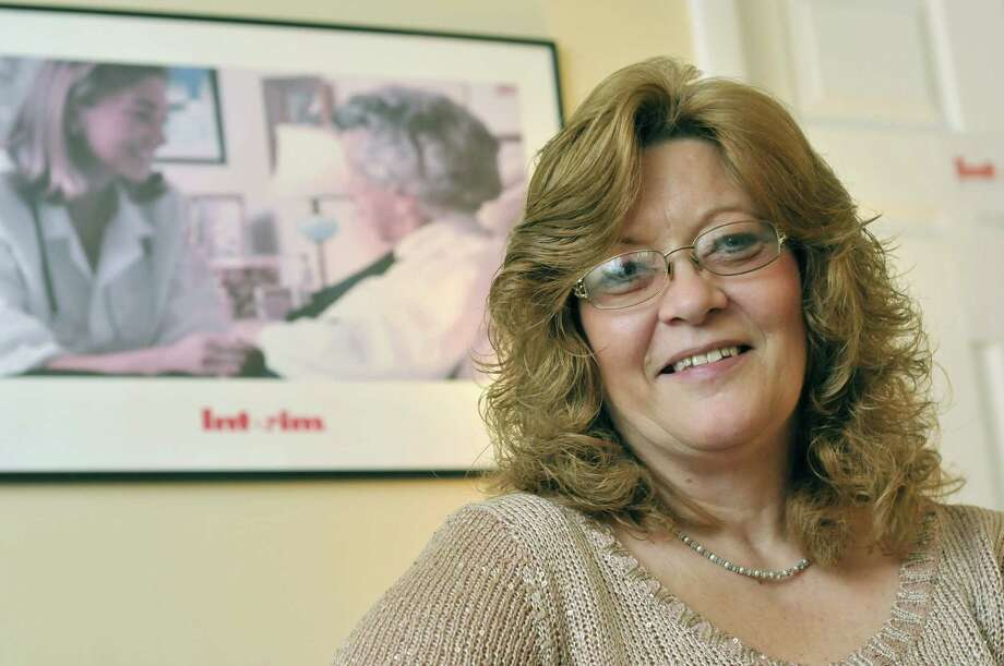 Lori Gregory poses at the Interim HealthCare office on Tuesday, Dec. 17, 2013 in Glens Falls, NY.  Gregory, a home health aide,  has recently been awarded the National Paraprofessional of the Year Award.   (Paul Buckowski / Times Union) Photo: PAUL BUCKOWSKI / 00025077A