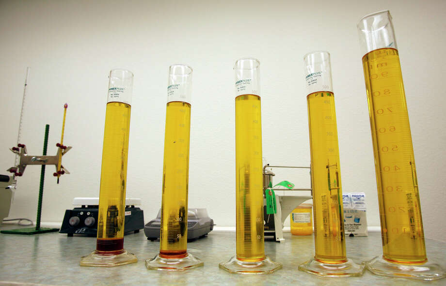 These samples of biodiesel range from the earliest stage of the process, left, to the final product at right. Texas is the nation's leading producer of biodiesel, used in bulldozers, generators and other heavy equipment. Photo: J. MICHAEL SHORT, FREELANCE / Freelance