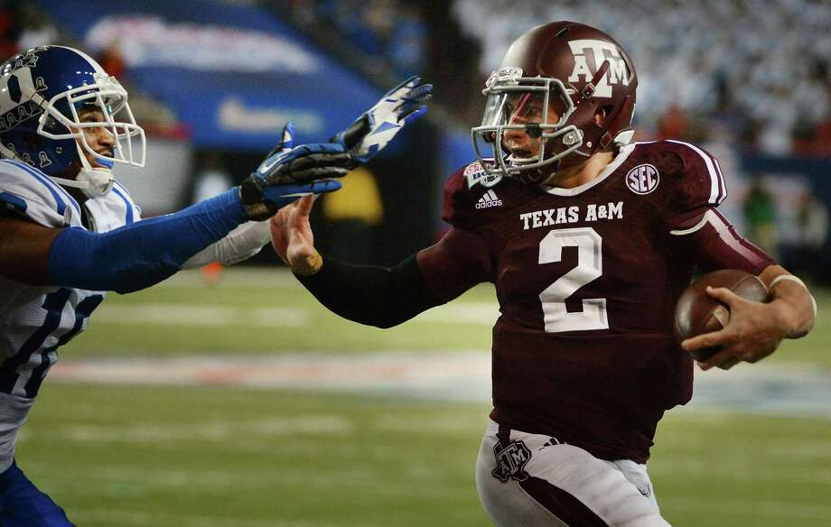 Johnny Manziel, in likely his final game at Texas A&M, managed to fend off a tough challenge from Duke. Photo: Chuck Liddy / McClatchy-Tribune News Service / Raleigh News & Observer