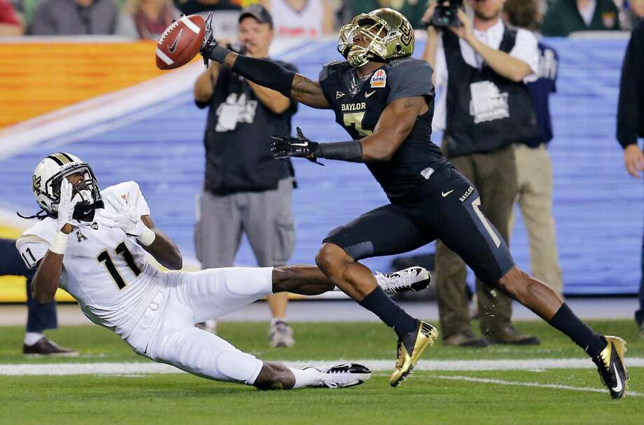 Baylor cornerback Demetri Goodson, right, breaks up a pass intended for Central Florida wide receiver Breshad Perriman during the first half of the Fiesta Bowl NCAA college football game, Wednesday, Jan. 1, 2014, in Glendale, Ariz. (AP Photo/Matt York) Photo: Matt York, Associated Press / AP