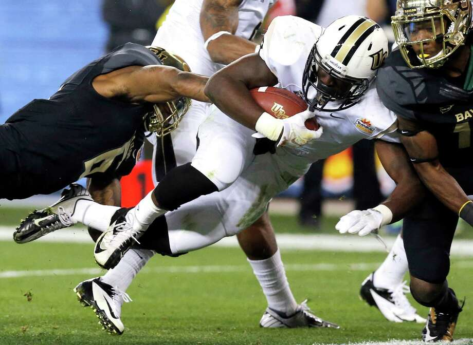 Central Florida running back Storm Johnson (8) scores a touchdown against Baylor during the first half of the Fiesta Bowl NCAA college football game, Wednesday, Jan. 1, 2014, in Glendale, Ariz.  (AP Photo/Ross D. Franklin) Photo: Ross D. Franklin, Associated Press / AP