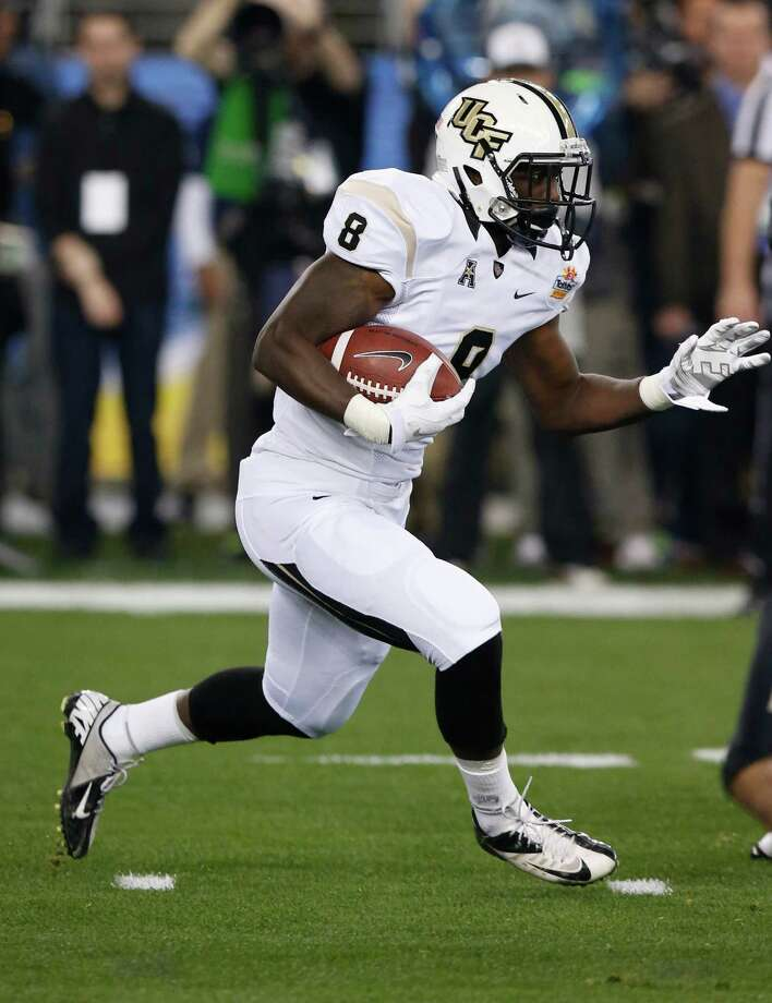 Central Florida running back Storm Johnson (8) runs against Baylor during the first half of the Fiesta Bowl NCAA college football game, Wednesday, Jan. 1, 2014, in Glendale, Ariz.  (AP Photo/Ross D. Franklin) Photo: Ross D. Franklin, Associated Press / AP