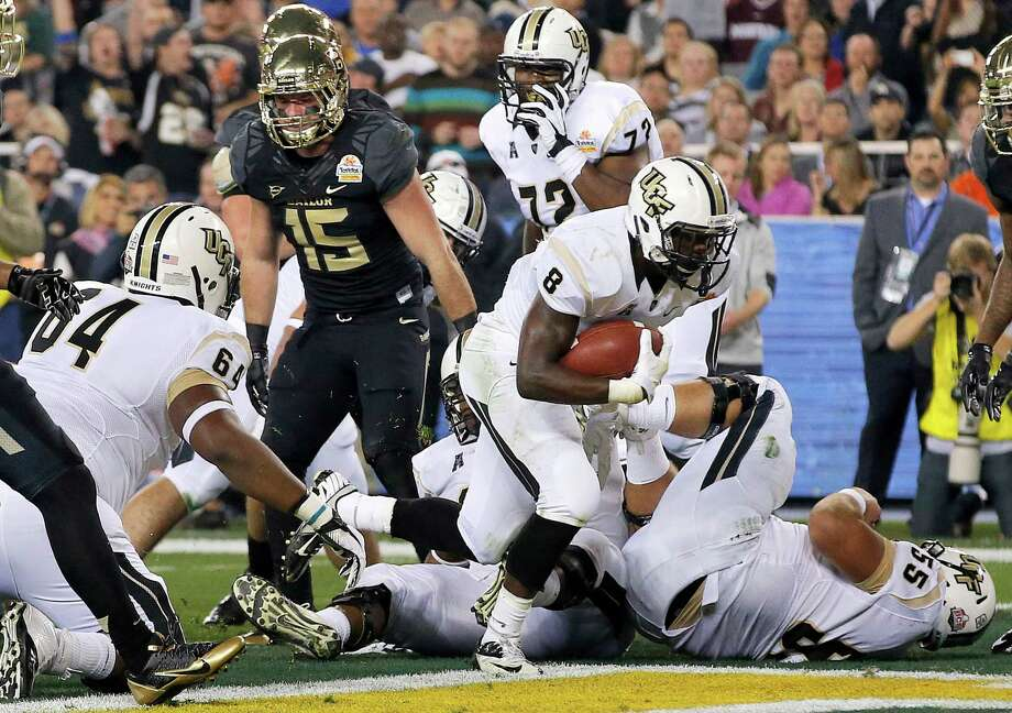 Central Florida running back Storm Johnson (8) scores his second touchdown during the first half of the Fiesta Bowl NCAA college football game against Butler, Wednesday, Jan. 1, 2014, in Glendale, Ariz. (AP Photo/Ross D. Franklin) Photo: Ross D. Franklin, Associated Press / AP
