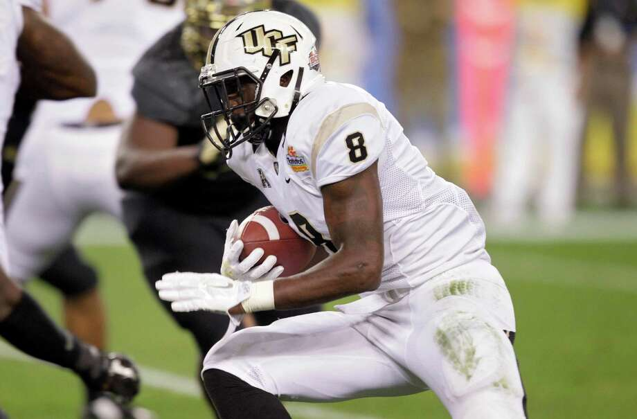 Central Florida running back Storm Johnson (8) runs in a touchdown against Baylor during the first half of the Fiesta Bowl NCAA college football game, Wednesday, Jan. 1, 2014, in Glendale, Ariz.  (AP Photo/Rick Scuteri) Photo: Rick Scuteri, Associated Press / FR157181 AP