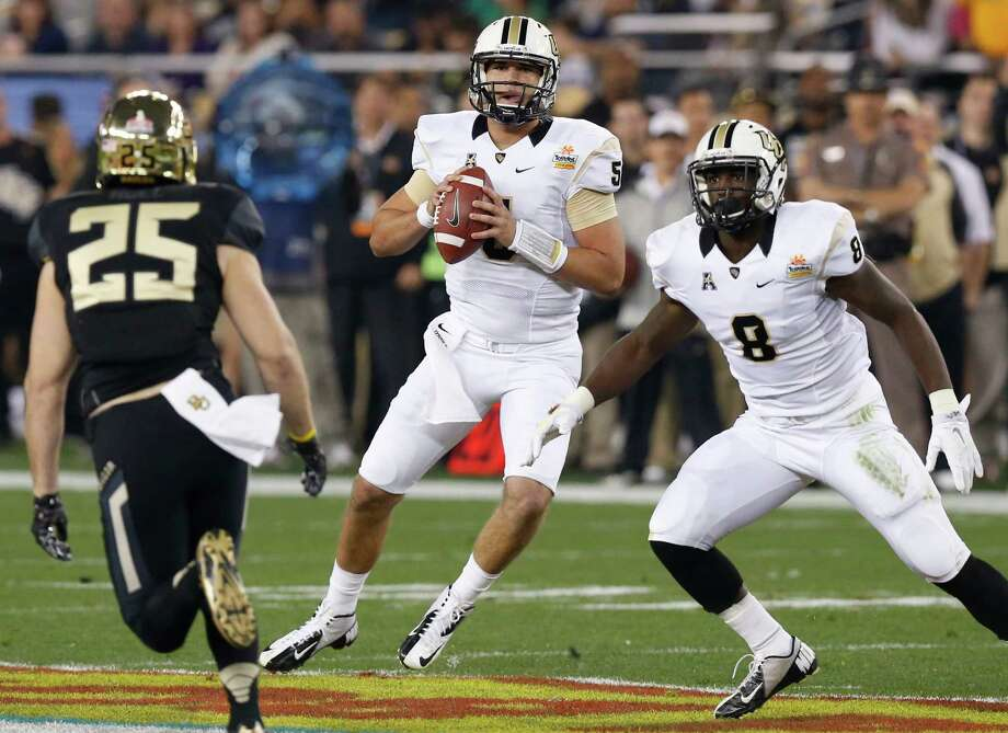 Central Florida quarterback Blake Bortles (5) looks to throw as teammate Storm Johnson (8) watches Baylor defensive back Sam Holl (25) during the first half of the Fiesta Bowl NCAA college football game, Wednesday, Jan. 1, 2014, in Glendale, Ariz. (AP Photo/Ross D. Franklin) Photo: Ross D. Franklin, Associated Press / AP