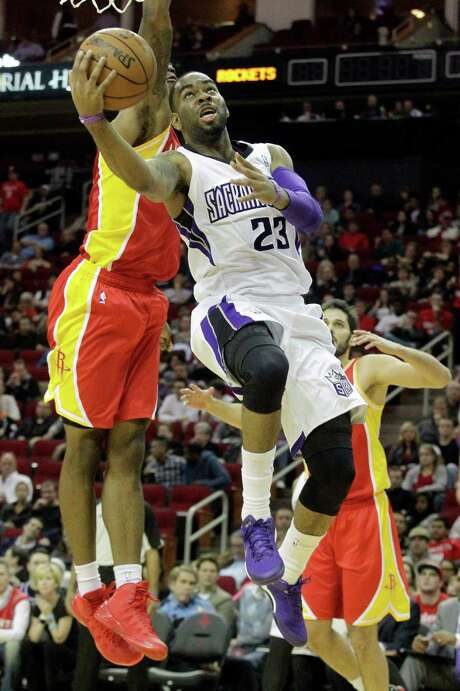 Sacramento Kings guard Marcus Thornton (23) lays the ball up over Houston Rockets forward Terrence Jones during the first period of an NBA basketball game, Tuesday, Dec. 31, 2013, in Houston. (AP Photo/Patric Schneider) Photo: Patric Schneider, FRE / FR170473 AP