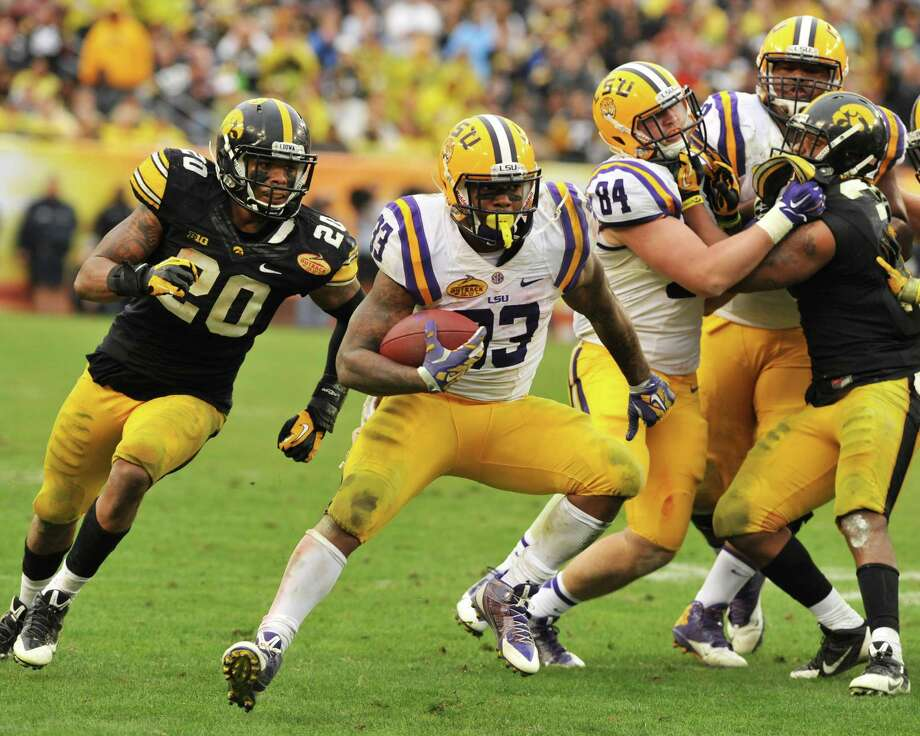 TAMPA, FL -  JANUARY 1:  Running back Jeremy Hill #33 of the LSU Tigers rushes upfield against the Iowa Hawkeyes January 1, 2014  in the Outback Bowl at Raymond James Stadium in Tampa, Florida.  LSU won 21-14. (Photo by Al Messerschmidt/Getty Images) ORG XMIT: 457133613 Photo: Al Messerschmidt / 2014 Getty Images