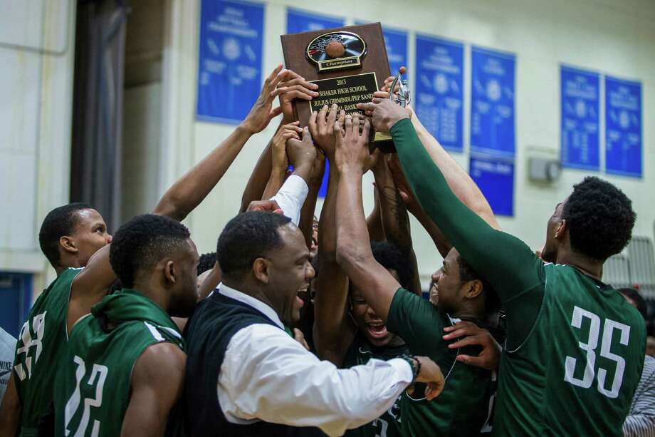 Green Tech head coach Jamil Hood Sr. celebrates with his team after defeating Shaker to win the Julius Girmindl/Pep Sand boys basketball tournament, Friday, Dec. 27, 2013 in Latham, N.Y. (Dan Little/ Special to the Times Union) Photo: Dan Little / Copyright Dan Little