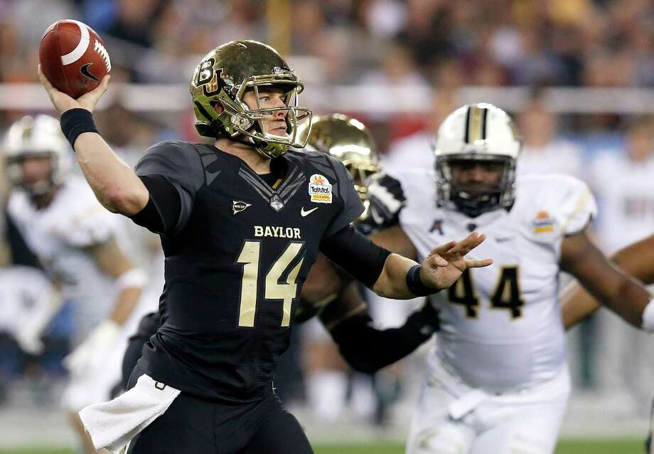 Baylor's Bryce Petty (14) gets off a pass as Central Florida's Miles Pace (44) is blocked during the first half of the Fiesta Bowl NCAA college football game Wednesday, Jan. 1, 2014, in Glendale, Ariz. (AP Photo/Ross D. Franklin) Photo: Ross D. Franklin, Associated Press / AP