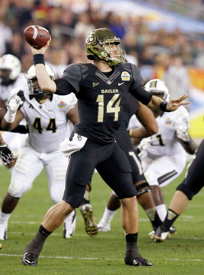 Baylor's Bryce Petty (14) passes against Central Florida during the first half of the Fiesta Bowl NCAA college football game Wednesday, Jan. 1, 2014, in Glendale, Ariz. (AP Photo/Ross D. Franklin) Photo: Ross D. Franklin, Associated Press / AP