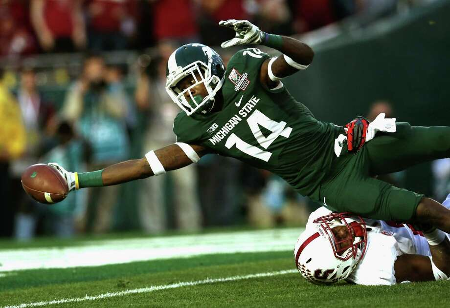 It's not a reach to suggest Tony Lippett was one of Michigan State's heroes in its win over Stanford. He scored the winning touchdown on a 25-yard reception. Photo: Stephen Dunn, Staff / 2014 Getty Images
