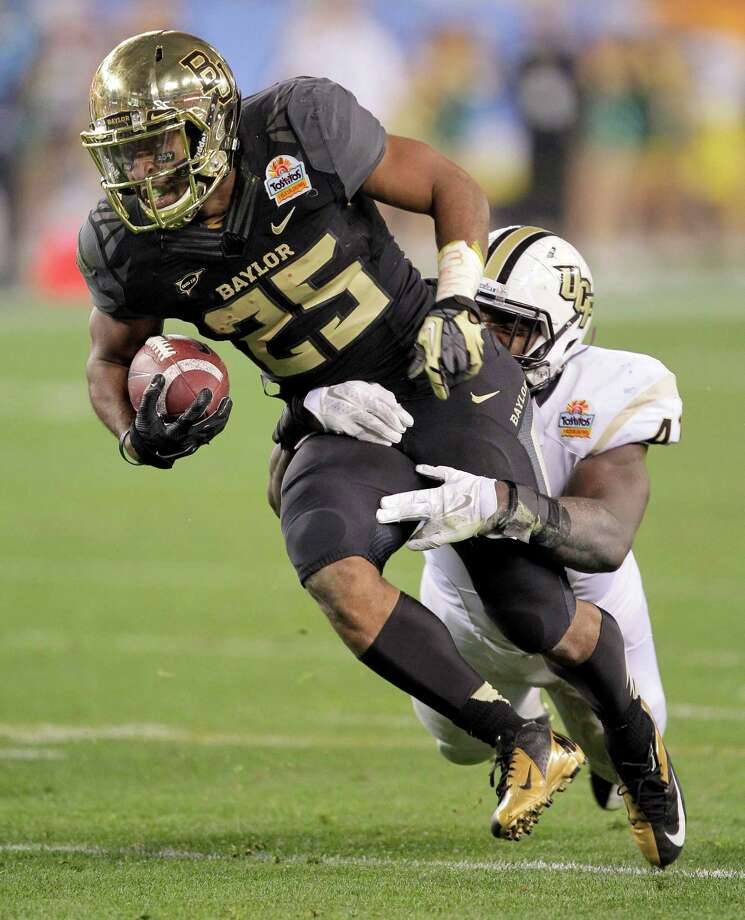 Baylor running back Lache Seastrunk (25) runs against  Central Florida during the first half of the Fiesta Bowl NCAA college football game, Wednesday, Jan. 1, 2014, in Glendale, Ariz.  (AP Photo/Rick Scuteri) Photo: Rick Scuteri, Associated Press / FR157181 AP