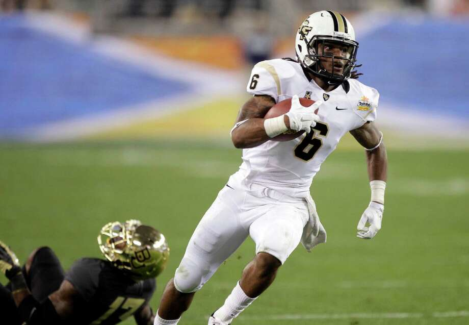Central Florida wide receiver Rannell Hall (6) breaks free from Baylor safety Terrell Burt for a touchdown during the first half of the Fiesta Bowl NCAA college football game, Wednesday, Jan. 1, 2014, in Glendale, Ariz. (AP Photo/Rick Scuteri) Photo: Rick Scuteri, Associated Press / FR157181 AP