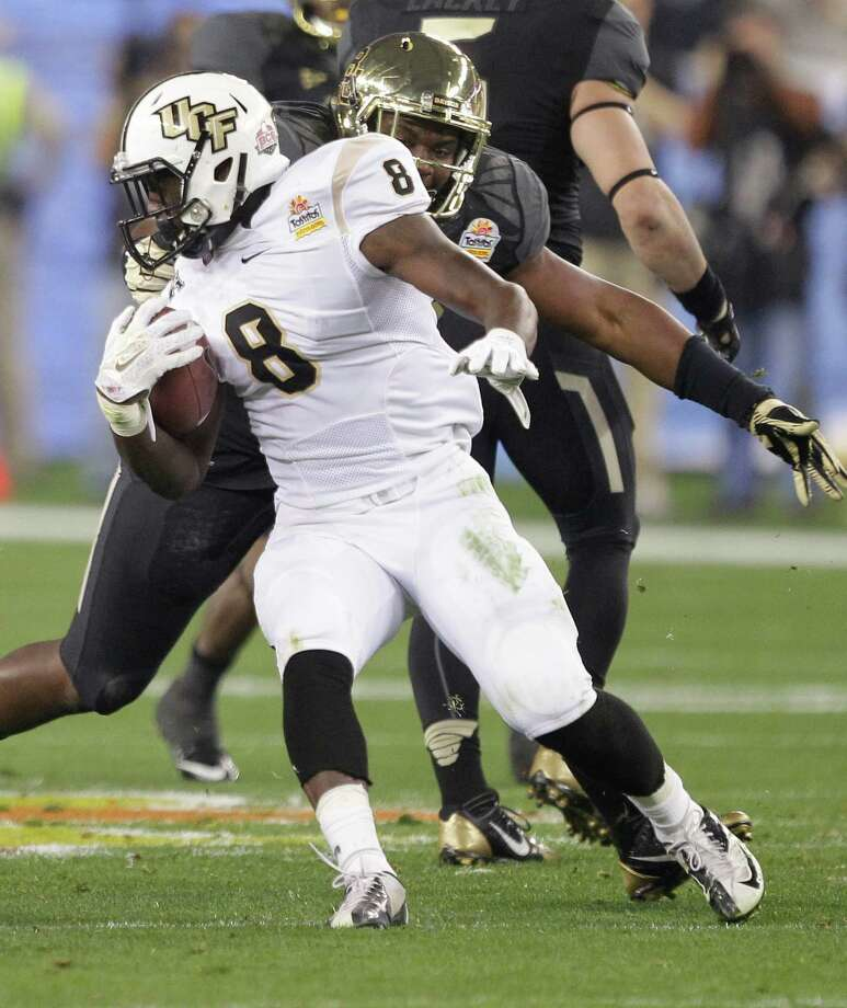 Central Florida running back Storm Johnson (8) runs against Baylor during the first half of the Fiesta Bowl NCAA college football game, Wednesday, Jan. 1, 2014, in Glendale, Ariz.  (AP Photo/Rick Scuteri) Photo: Rick Scuteri, Associated Press / FR157181 AP