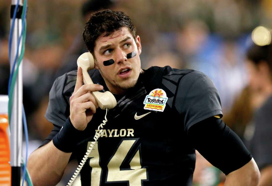 Baylor quarterback Bryce Petty talks to his coaches during the first half of the Fiesta Bowl NCAA college football game against Central Florida, Wednesday, Jan. 1, 2014, in Glendale, Ariz.  (AP Photo/Ross D. Franklin) Photo: Ross D. Franklin, Associated Press / AP