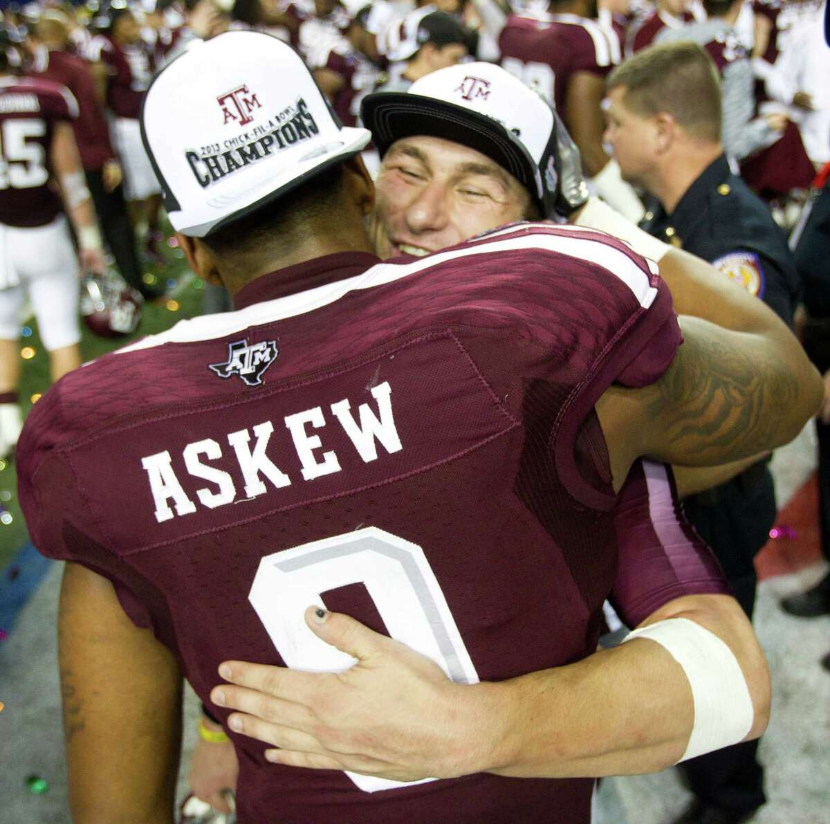 Johnny Manziel, right, and senior linebacker Nate Askew enjoy the Aggies' victory Tuesday night in what was definitely Askew's final college game and probably the finale for the redshirt sophomore quarterback as well.