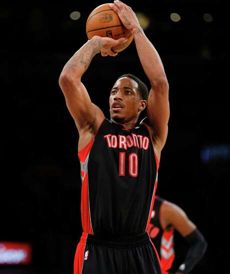 Toronto Raptors' DeMar DeRozan shoots a free throw against the Los Angeles Lakers during the second half of an NBA basketball game in Los Angeles, Sunday, Dec. 8, 2013. The Raptors won 106-94. (AP Photo/Danny Moloshok) Photo: Danny Moloshok, FRE / FR161655 AP