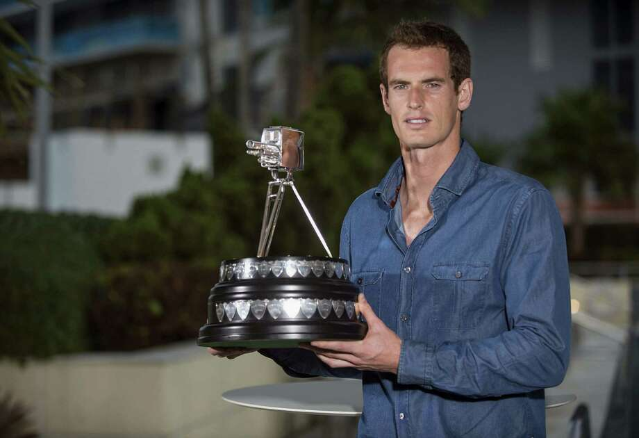 In this photo made available by the BBC, British Broadcasting Corporation,  British tennis player Andy Murray poses with his award, in Miami, Florida, Sunday, Dec. 15, 2013.  Wimbledon Champion Andy Murray was named as the BBC Sports Personality of the Year 2013.  (AP Photo/Josh Ritchie) Photo: Josh Ritchie, HOEP / BBC