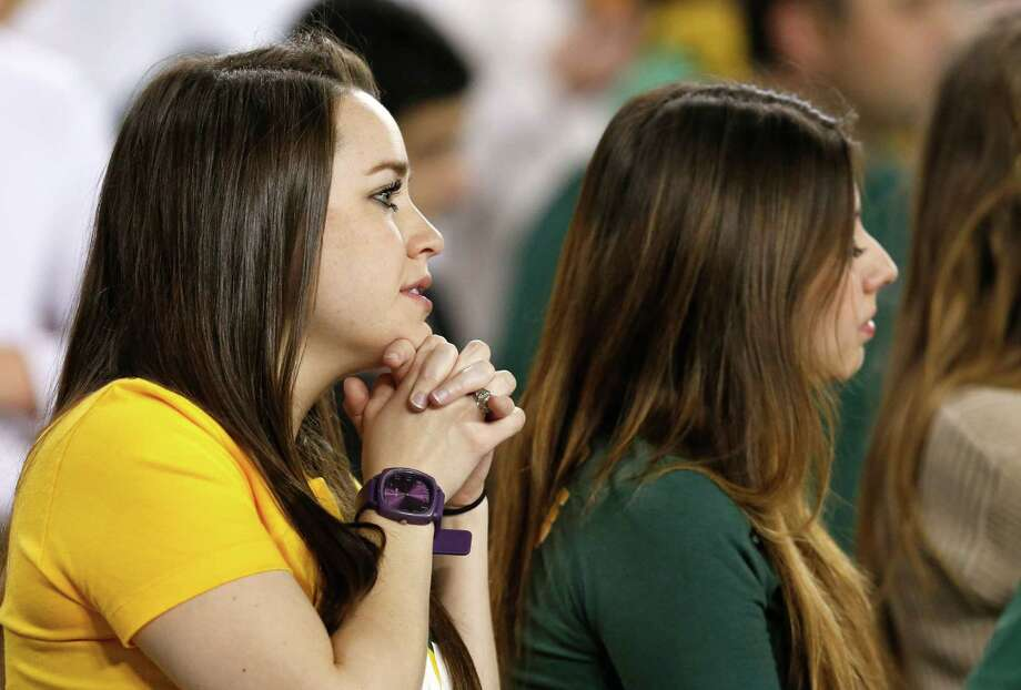 Baylor fans watch during the first half of the Fiesta Bowl NCAA college football game between Baylor and Central Florida on Wednesday, Jan. 1, 2014, in Glendale, Ariz. (AP Photo/Ross D. Franklin) Photo: Ross D. Franklin, Associated Press / AP