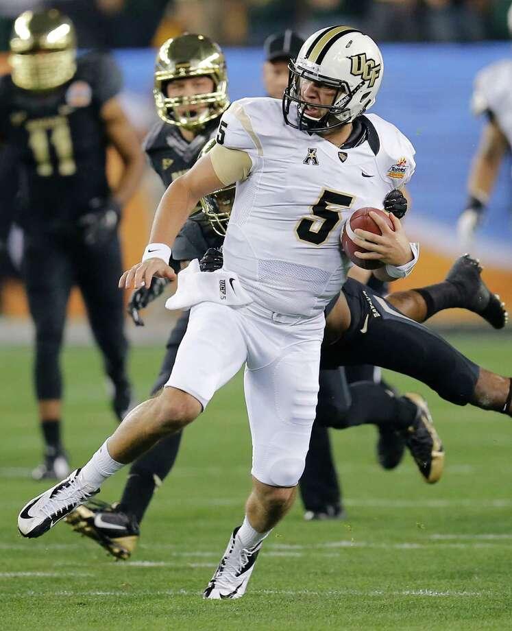 UCF's Blake Bortles hurt the Baylor defense with his feet (more than 11 yards per rush) and arm (three TD passes). Photo: Matt York, STF / AP
