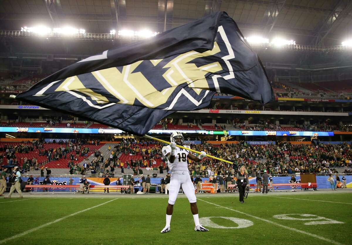 GLENDALE, AZ - JANUARY 01: Wide receiver Josh Reese #19 of the UCF Knights waves a flag on the field after defeating the Baylor Bears 52-42 in the Tostitos Fiesta Bowl at University of Phoenix Stadium on January 1, 2014 in Glendale, Arizona.