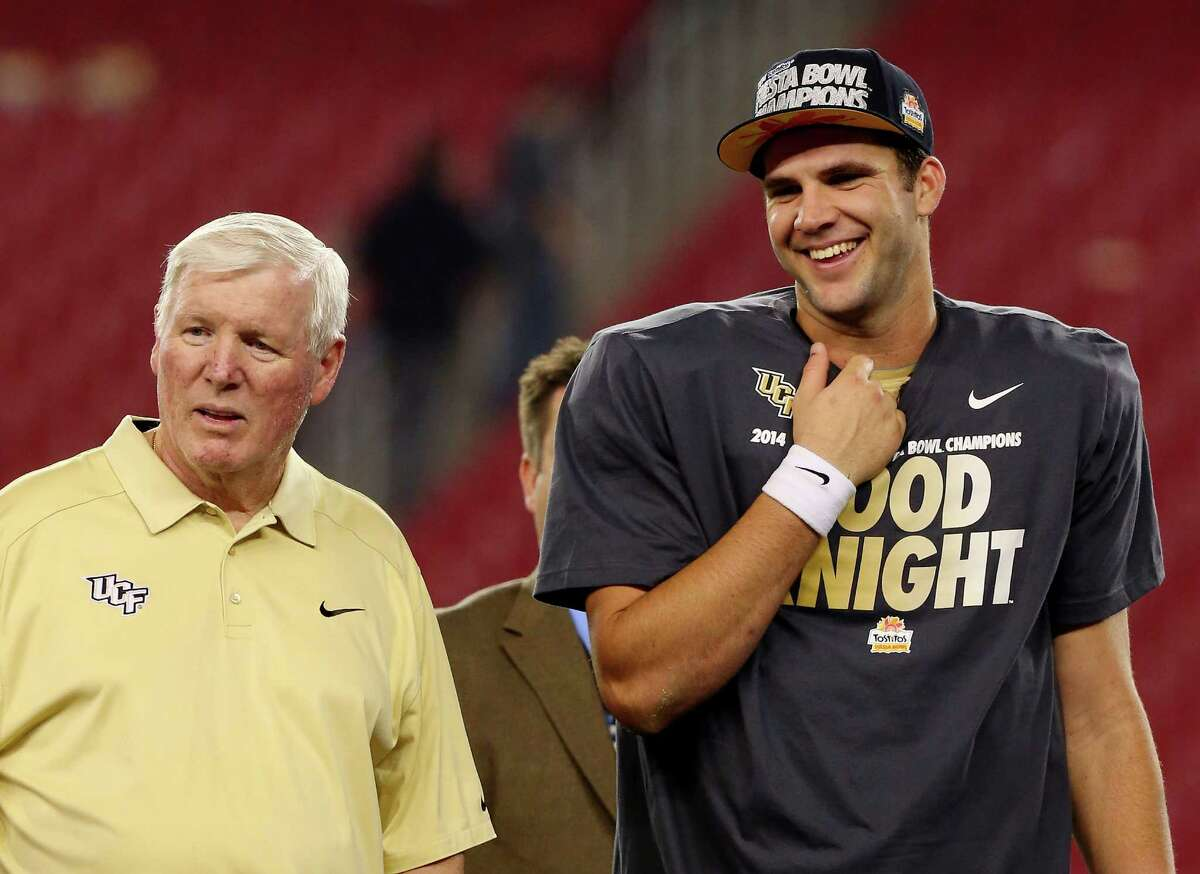 GLENDALE, AZ - JANUARY 01: Head coach George O'Leary (L) and quarterback Blake Bortles #5 of the UCF Knights stand on the stage after defeating the Baylor Bears 52-42 in the Tostitos Fiesta Bowl at University of Phoenix Stadium on January 1, 2014 in Glendale, Arizona.