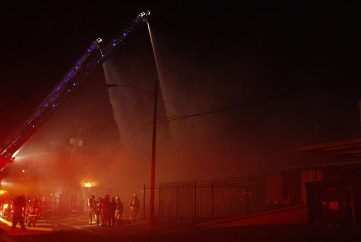 Firefighters battle a blaze on Peerless near Dixie.