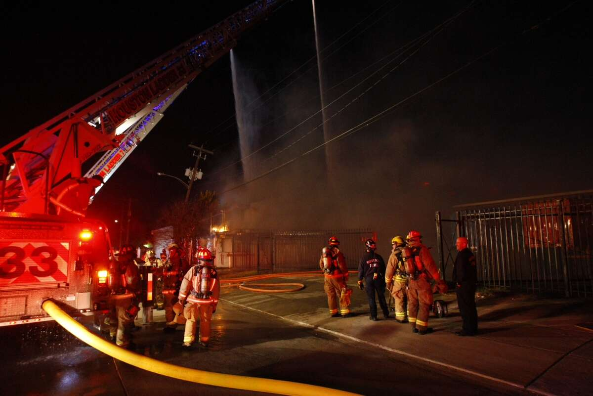 Firefighters battle a blaze on Peerless near Dixie early Thursday morning, Jan. 2, 2014.