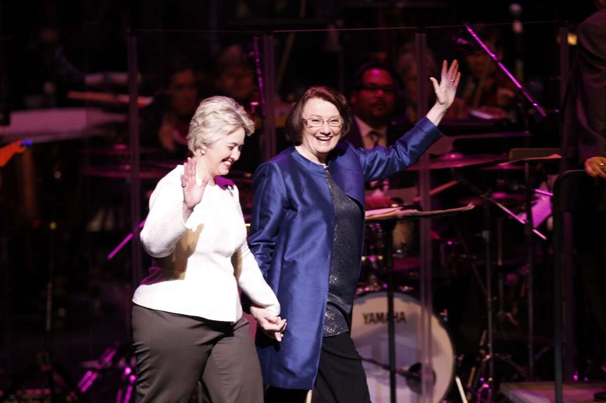 Houston Mayor Annise Parker celebrates with her partner Kathy Hubbard at her inauguration at the Wortham Theater Center Jan. 2, 2014.