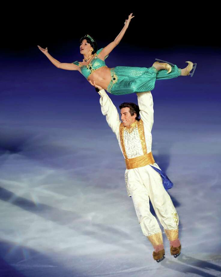 "Aladdin lifts Jasmine in a scene from the Disney on Ice production of ""Princesses & Heroes,"" which runs through Jan. 5, 2014, at the Webster Bank Arena in Bridgeport, Conn. Photo: Contributed Photo / Connecticut Post Contributed"