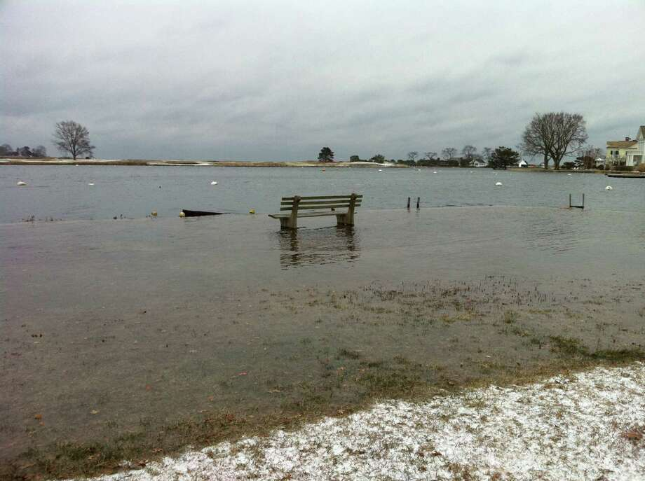 Areas along the shore not only have to worry about the snow that is on the way, they also have to deal with extremely high tides. The water was up over the seawall in Southport harbor Thursday morning. Photo: Genevieve Reilly / Fairfield Citizen