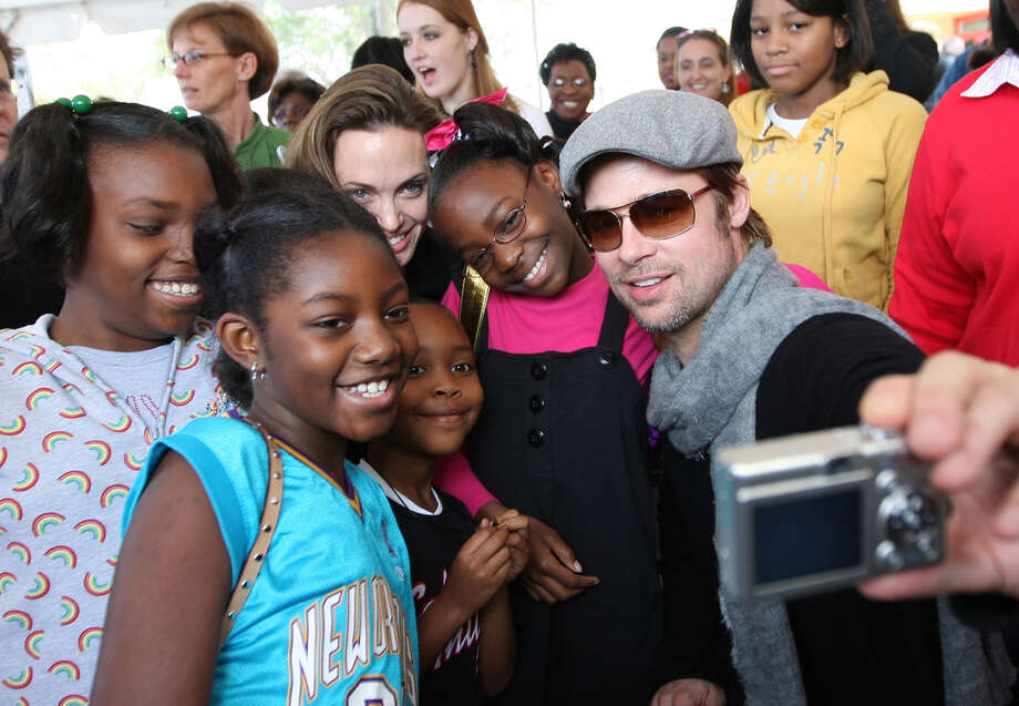 "Actress Angelina Jolie and actor Brad Pitt attend The Childrens Health Fund ""Raise Awareness"" event at the Martin Luther King Jr. Charter School on December 22, 2007 in New Orleans, Louisiana. Photo: Jason Kempin, WireImage / 2007 WireImage"